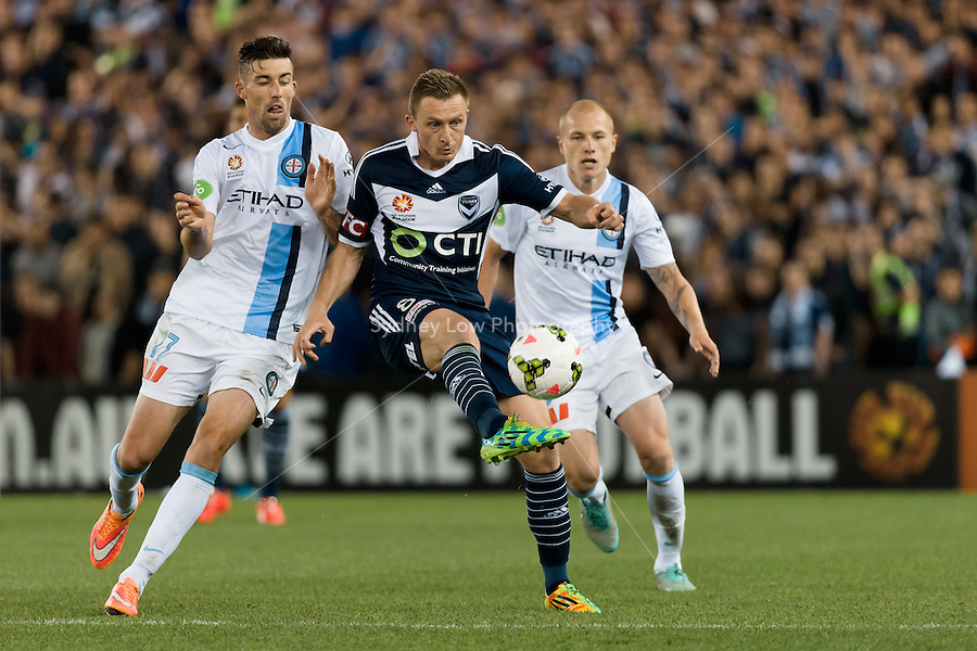 Besart BERISHA of the Victory clears the ball in the round 3 match between Melbourne  Victory and Melbourne City in the Australian Hyundai A-League 2014-15 season at Etihad Stadium, Melbourne, Australia.