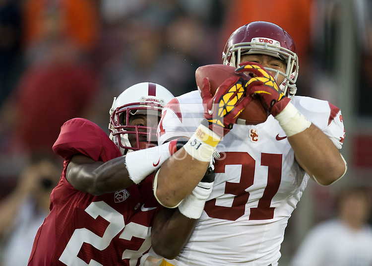 Stanford, CA -- September 15, 2012:  Ronnie Harris stops a catch during Stanford's regular season opening game vs USC. Stanford defeated the Trojans 21-14.