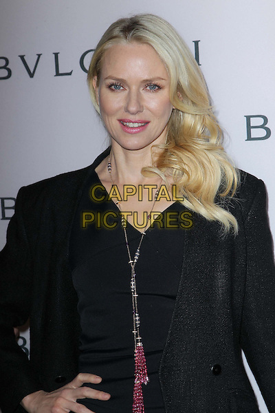 Naomi Watts.BVLGARI celebrates Elizabeth Taylor's magnificent collection of BVLGARI jewelry held at the BVLGARI store, Beverly Hills, California, USA..February 19th, 2013.half length black dress blazer pink necklace tassels beads beaded hand on hip.CAP/ADM/FS.©Faye Sadou/AdMedia/Capital Pictures.