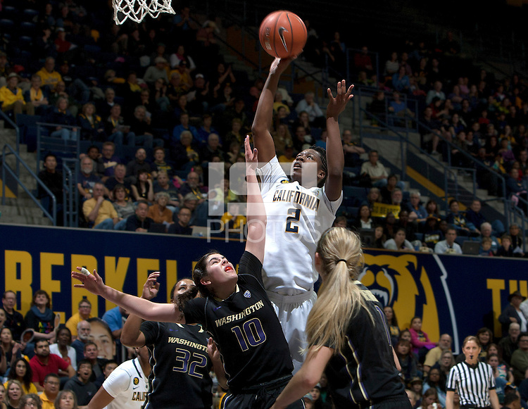 Afure Jemerigbe of California shoots the ball during the game against Washington at Haas Pavilion in Berkeley, California on March 1st, 2014.   Washington defeated California, 70-65.
