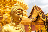 Gold layered upon more gold glistens in the Wat Phra That Doi Suthep Temple.