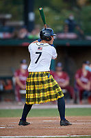 Savannah Bananas Juan Colato (7) bats during a Coastal Plain League game against the Macon Bacon on July 15, 2020 at Grayson Stadium in Savannah, Georgia.  Savannah wore kilts for their St. Patrick's Day in July promotion.  (Mike Janes/Four Seam Images)