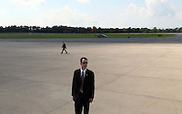 Secret service await the arrival of President Barack Obama at the Charlottesville/Albemarle Airport in Charlottesville, VA.