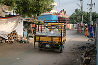 A delivery vehicle supplies bottled water to the local residents in Medak, Telangana, India.