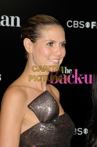 """HEIDI KLUM.arriving at the premiere of CBS Films' """"The Back-up Plan"""" at the Regency Village Theatre in Westwood, California, USA, April 21st, 2010..arrivals portrait headshot hair scarped up back make-up beauty strapless brown shimmery shiny sparkly bronze gold pink purple sequined sequin green khaki smiling profile bun .CAP/`ROT.©Lee Roth/Capital Pictures"""