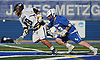 Angelo Petrakis #28 of Massapequa, left, and Tommy Dover #18 of Port Washington battle for control of a faceoff during the Nassau County varsity boys lacrosse Class A semifinals at Shuart Stadium, located on the campus Hofstra University in Hempstead, on Thursday, May 24, 2018. Massapequa scored six unanswered goals in the fourth quarter to win by a score of 11-3.