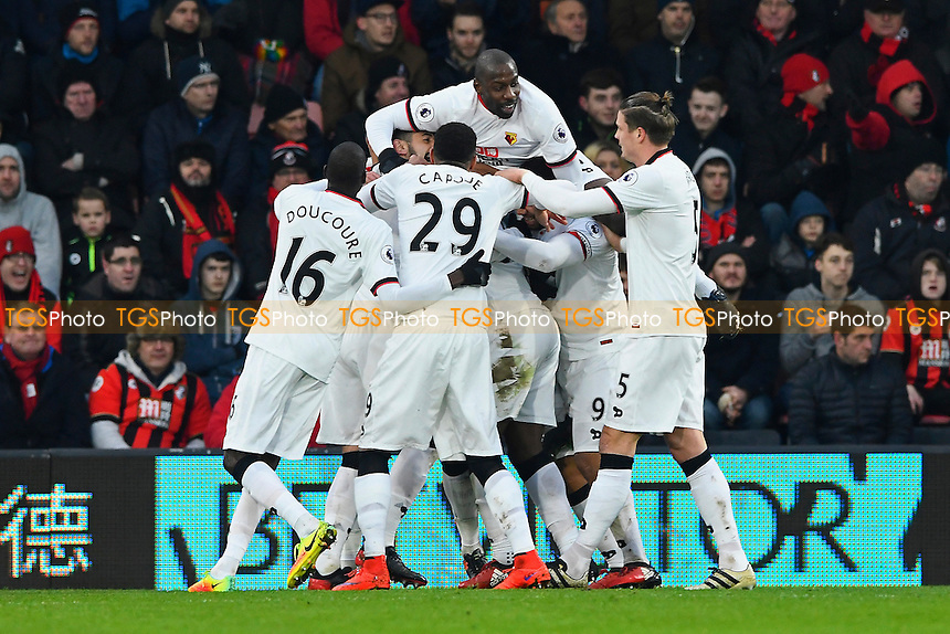 Watford players mob goalscorer Christian Kabasele of Watford during AFC Bournemouth vs Watford, Premier League Football at the Vitality Stadium on 21st January 2017