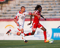 Stanley Nyazamba (99) of the Richmond Kickers fights for the ball with Perry Kitchen (23) of D.C. United during a third round match in the US Open Cup at City Stadium in Richmond, VA.  D.C. United advanced on penalty kicks after tying the Richmond Kickers, 0-0.