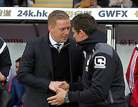 Swansea manager Garry Monk (L) greets a Bournemouth coach before the Barclays Premier League match between Swansea City and Bournemouth at the Liberty Stadium, Swansea on November 21 2015