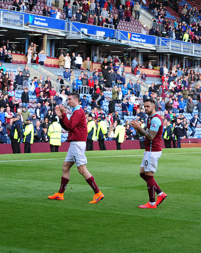 Burnley's Danny Ings, right, leaves the pitch after the lap of hounour<br /> <br /> Photographer Andrew Vaughan/CameraSport<br /> <br /> Football - Barclays Premiership - Burnley v Stoke City - Saturday 16th May 2015 - Turf Moor - Burnley<br /> <br /> &copy; CameraSport - 43 Linden Ave. Countesthorpe. Leicester. England. LE8 5PG - Tel: +44 (0) 116 277 4147 - admin@camerasport.com - www.camerasport.com