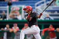 Batavia Muckdogs center fielder Brayan Hernandez (18) follows through on a swing during a game against the Williamsport Crosscutters on June 22, 2018 at Dwyer Stadium in Batavia, New York.  Williamsport defeated Batavia 9-7.  (Mike Janes/Four Seam Images)