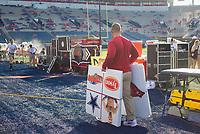 NWA Democrat-Gazette/CHARLIE KAIJO Arkansas Razorbacks staff carry out play cards before a football game, Saturday, September 7, 2019 at Vaught-Hemingway Stadium in Oxford, Miss.