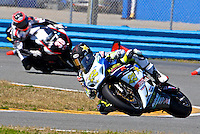 Tommy Hayden (22) leads another rider during the AMA SuperBike motorcycle race at Daytona International Speedway, Daytona Beach, FL, March 2011.(Photo by Brian Cleary/www.bcpix.com)