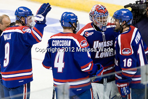 Terrence Wallin (UML - 9), Tim Corcoran (UML - 4), Doug Carr (UML - 31), Riley Wetmore (UML - 16) - The University of Massachusetts-Lowell River Hawks defeated the Miami University Redhawks 4-3 (OT) in their NCAA East Regional semifinal on Friday, March 23, 2012, at the Webster Bank Arena in Bridgeport, Connecticut.