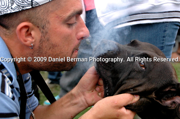 Mike blows marijuana smoke into the face of his dog Cash at Myrtle Edwards Park on the first day of Hempfest Seattle Saturday August 15, 2009. Photo by Daniel Berman/SeattlePI.com