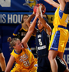 BROOKINGS, SD - DECEMBER 11:  Clarissa Ober #21 from South Dakota State University battles for the ball with Brianna Cummings #5 from George Washington during their game Sunday afternoon at Frost Arena in Brookings. (Photo by Dave Eggen/Inertia)