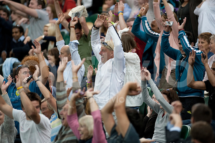 Spectators celebrates  during the match between Novak Djokovic (SRB) and Olivier Rochus (BEL). The Wimbledon Championships 2010 The All England Lawn Tennis & Croquet Club  Day 1 Monday 21/06/2010
