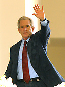 Washington, D.C. - July 26, 2007 -- United States President George W. Bush waves as he returns to the Oval Office following Special Olympics Global Law Enforcement Torch Run Ceremony in the Rose Garden of the White House in Washington, D.C. on Thursady, July 26, 2007. <br /> Credit: Ron Sachs / Pool via CNP