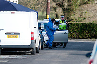 Tuesday 18 February 2014<br /> Pictured: Foriensic activity at  the Police cordon at New Road Pontyberem<br /> Re:A dog has been seized by police following the sudden death of a baby in Carmarthenshire.Officers say they had a call alerting them to the incident at a property in New Road, Pontyberem, shortly before 08:30 GMT on Tuesday.The baby was airlifted to the University Hospital of Wales, Cardiff, the Welsh Ambulance Service said.The dog involved in the incident was an Alaskan Malamute, similar to a Husky, which is not a banned breed.