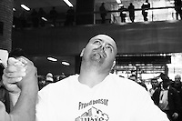 "Chris Perka waits for his match to begin at the Empire State Finals at the Port Authority Bus Terminal in New York City on November 17, 2005.  The Empire State Finals is the culmination in the year of the New York City Arm Wrestling Association's ""Golden Arm Series""."