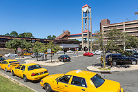 Taxis wait for passengers in the taxi line outside the White Plains Metro-North Railroad station in White Plains, New York.
