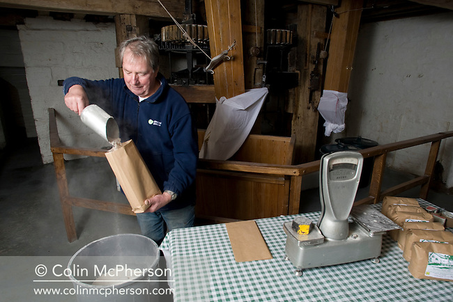 Dennis Buchanan who runs Bunbury Water Mill in the Cheshire village of Bunbury, filling freshly-ground flour into bags, pictured as part of the Cheshire Food Trail. A mill has existed in Bunbury since 1290 and the present building was restored by United Utilities in 1977 and now produces flour for various outlets as well as providing tours and educational visits for schools.