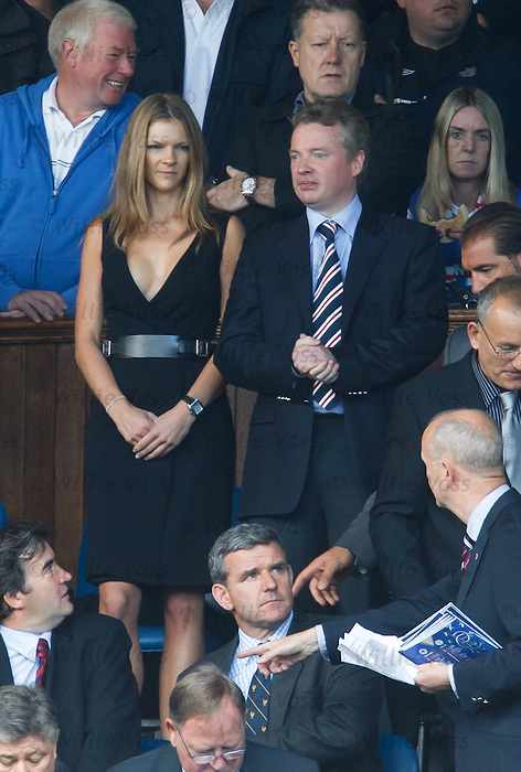 Craig Whyte and partner in the directors box