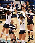 SIOUX FALLS, SD - OCTOBER 14: Becca Finley #4 and Bailey Koch #14 from Augustana looks to block a kill by Samantha Lovell #17 from the University of Sioux Falls in the first game of their match Tuesday night at the Elmen Center. (Photo by Dave Eggen/Inertia)