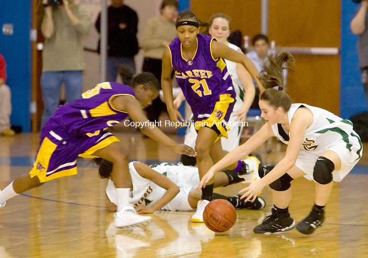 NEW BRITAIN, CT--10 MARCH 2007--031007JS21- Holy Cross' Kaitlin Ciarleglio, right, gets fouled by Career Magnet's Anisha Wilson as they both go  for a loose ball Class M state finals Saturday at Central Connecticut State University in New Britain. <br /> Jim Shannon / Republican-American