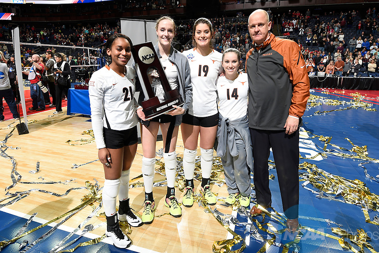 COLUMBUS, OH - DECEMBER 17:  The University of Texas receives their national runner-up trophy during the Division I Women's Volleyball Championship held at Nationwide Arena on December 17, 2016 in Columbus, Ohio.  Stanford defeated Texas 3-1 to win the national title. (Photo by Jamie Schwaberow/NCAA Photos via Getty Images)