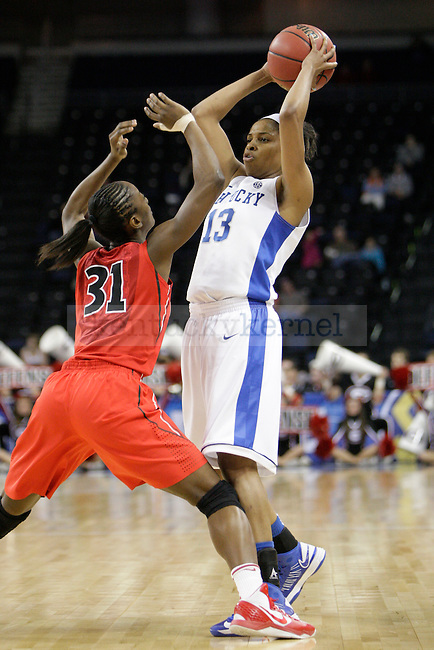 UK Bria Goss looks to pass the ball during the second half of the University of Kentucky women's basketball game vs. the University of Georgia during the SEC Tournament at The Arena at Gwinnett Center in Duluth, Ga., on Saturday, March 9, 2013. UK won 60-38. Photo by Tessa Lighty | Staff