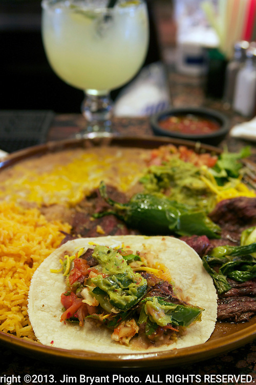 Tequila, Carne Asada, beef, Mexican Rice, refried beans, salsa, onions, green pepper and tequila margarita.  ©2013. Jim Bryant Photo. ALL RIGHTS RESERVED.
