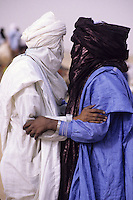 In-Gall, Niger, near Agadez.  Two Tuareg Men Greeting Each Other.