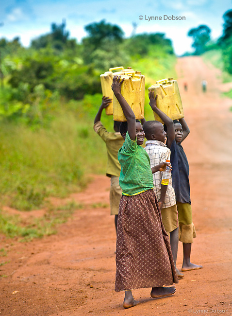 These children are carrying about 45 lbs of water in each jerry can.  A typical household of 5-6 family members in Uganda uses  6-8 jerry cans of water, about 120 to 140 liters a day…You see this all day every day, children walking or riding bikes pushing the bikes loaded with water. And yet they smile….