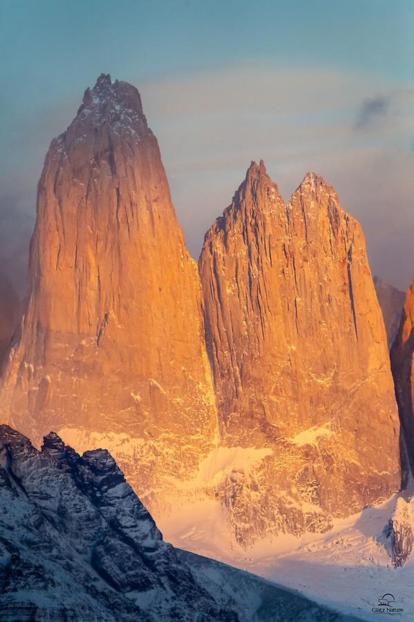 "Two of the three towers that give Torres del Paine (""Towers of Blue"") it's name. Got some nice morning light on them on a clear day. See we do landscapes too lol."