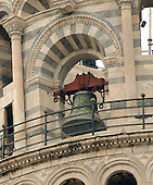 Pisa, Italy - March 28, 2006 -- Close-up of one of the bells at the top of the Leaning Tower of Pisa in Pisa, Italy on March 28, 2006.  The tower, which tilts or leans 17 feet, 6 inches (5.4 meters) from vertical, was begun in 1173 and completed in 1350. The bells add to the pressure on the tower to lean.  Galileo Galilei an Italian scientist who was born in Pisa, formulated the basic law of falling bodies, which he verified by careful measurements by dropping objects from the top of the tower..Credit: Ron Sachs / CNP