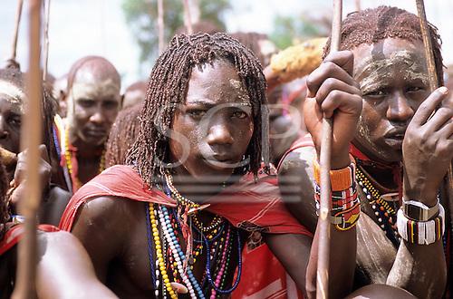 Lolgorian, Kenya. Siria Maasai; Eunoto ceremony; moran with white ochre body paint, bead adornments, braided hair.