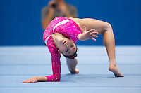 Kyla Ross on floor exercise during all around finals at 2013 Worlds Gymnastics in Antwerp, Belgium.  2013 Worlds Artistic Gymnastics Championships