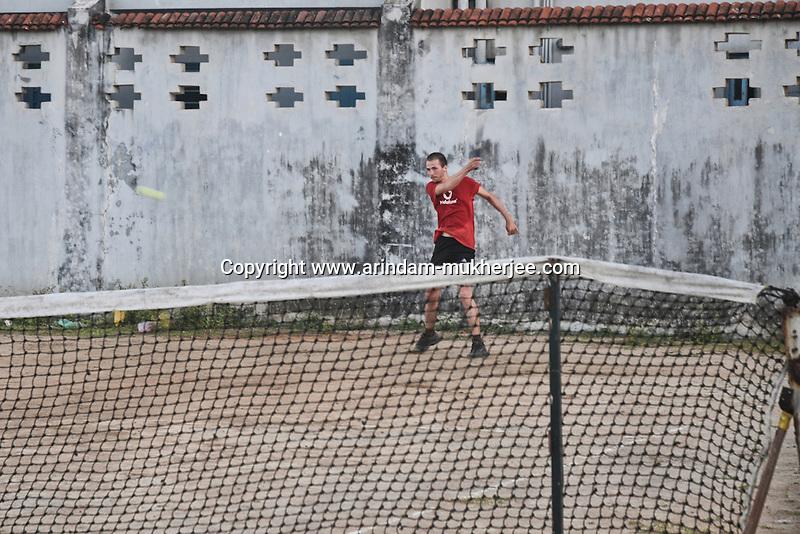 A resident playing the game of lawn tennis in Pondicherry. Arindam Mukherjee