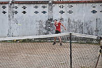 A resident playing the game of lawn tennis in Pondicherry. Arindam Mukherjee