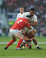 Billy Vunipola of England is tackled by Scott Baldwin of Walesduring the RBS 6 Nations match between England and Wales at Twickenham Stadium on Saturday 12th March 2016 (Photo: Rob Munro/Stewart Communications)