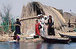 Marsh Arabs. Southern Iraq. Circa 1985. Marsh Arab family on traditional reed island called a dibin or kibasha. Haur al Mamar or Haur al-Hamar marsh collectively known now as Hammar marshes Irag 1984