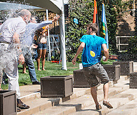 Matt Swanson '14 (blue shirt) trades water balloons with Oxy President Jonathan Veitch. Rehearsal for commencement, including the traditional water balloon fight, Friday, May 16, 2014. (Photo by Marc Campos, Occidental College Photographer)