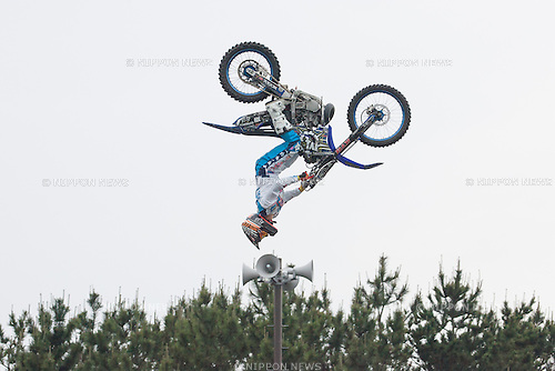 A motorcyclist performs a stunt at the 2015 Red Bull Air Race on May 16th, 2015 in Chiba, Japan.<br /> This is the first time the Red Bull Air Race has been held in Japan and some 60,000 spectators attended the qualifying day for Round 2 in the World Championship. (Photo by Michael Steinebach/Aflo)
