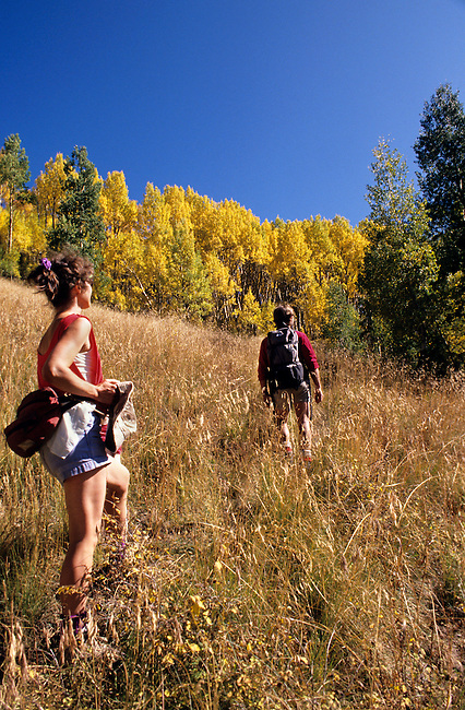 Model Released, Two Hikers, a Man and a Woman,  La Plata Canyon, Autumn, Aspen Trees, San Juan National Forest, Colorado, USA, North America
