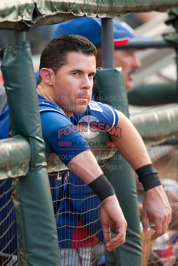 "Texas Rangers designated hitter Michael Young #10 in the dugout during the MLB exhibition baseball game against the ""AAA"" Round Rock Express on April 2, 2012 at the Dell Diamond in Round Rock, Texas. The Rangers out-slugged the Express 10-8. (Andrew Woolley / Four Seam Images)."