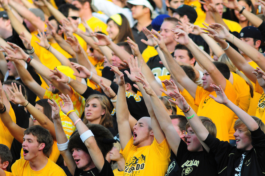18 October 08: Colorado fans in black and gold hope to jinx a kickoff by Kansas State. The Colorado Buffaloes defeated the Kansas State Wildcats 14-13 at Folsom Field in Boulder, Colorado.