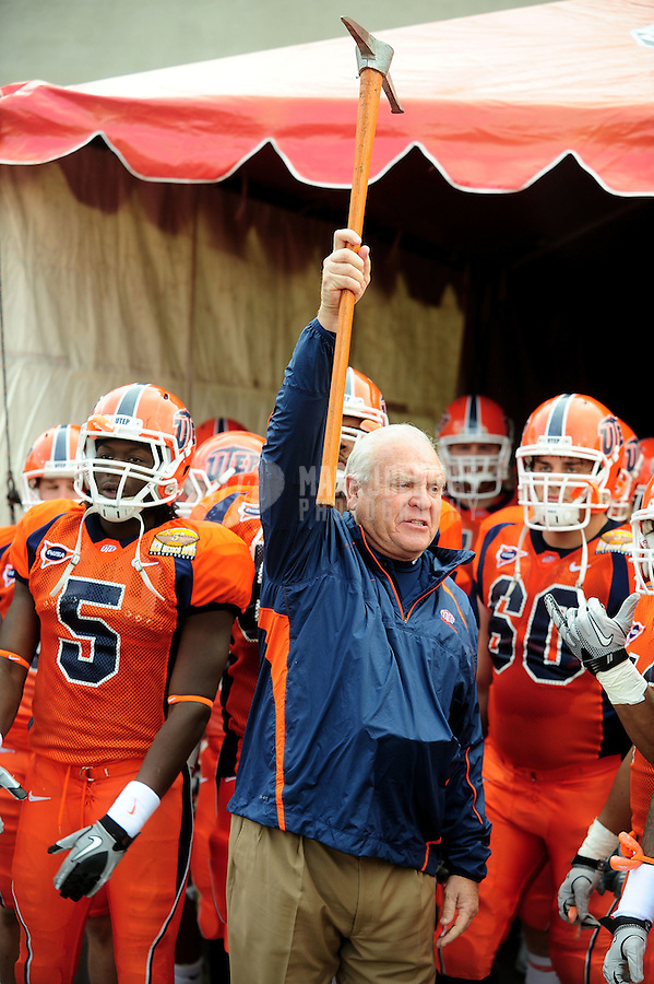 Dec. 18, 2010; Albuquerque, NM, USA; UTEP Miners head coach Mike Price holds a miners pick above his head against the BYU Cougars in the 2010 New Mexico Bowl at University Stadium. BYU defeated UTEP 52-24. Mandatory Credit: Mark J. Rebilas-