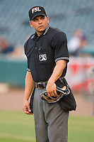 Home plate umpire Roberto Medina between innings during a Florida State League game between the Charlotte Stone Crabs and the Jupiter Hammerheads at Roger Dean Stadium June 15, 2010, in Jupiter, Florida.  Photo by Brian Westerholt /  Seam Images
