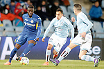 Getafe's Karim Yoda (l) and Celta de Vigo's Fabian Orellana (c) and Iago Aspas during La Liga match. February 27,2016. (ALTERPHOTOS/Acero)